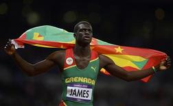 Grenada's Kirani James celebrates after winning the men's 400m final at the London 2012 Olympic Games at the Olympic Stadium August 6, 2012. REUTERS/Dylan Martinez