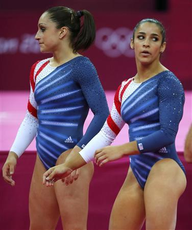 Alexandra Raisman (R) of the U.S. is seen with team mate Jordyn Wieber after competing in the women's gymnastics floor exercise final in the North Greenwich Arena during the London 2012 Olympic Games August 7, 2012. REUTERS/Mike Blake