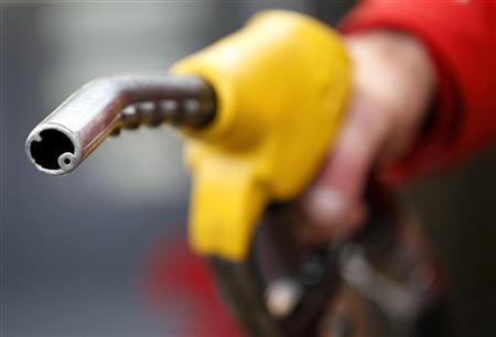 An attendant prepares to refuel a car at a petrol station in Rome January 4, 2012. REUTERS/Max Rossi