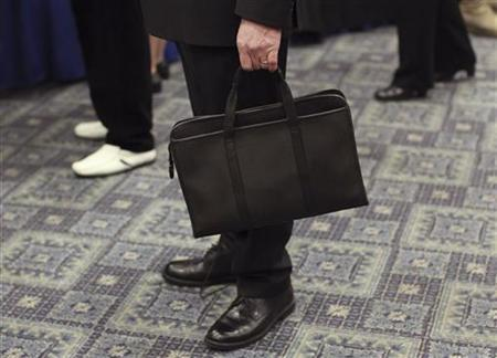 A man holds his briefcase at a job fair in New York April 18, 2012. REUTERS/Shannon Stapleton