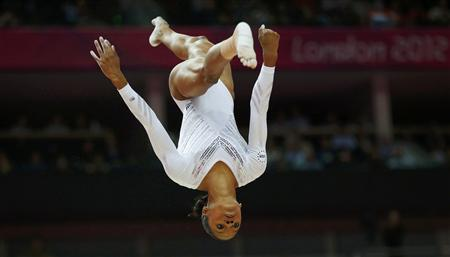 Gabrielle Douglas of the U.S. competes in the women's gymnastics balance beam final in the North Greenwich Arena during the London 2012 Olympic Games August 7, 2012. REUTERS/Brian Snyder
