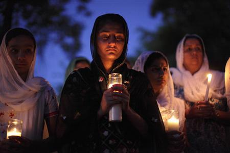 Mourners attend a candlelight vigil at the Sikh temple in Brookfield, Wisconsin, on August 6, 2012. REUTERS/John Gress