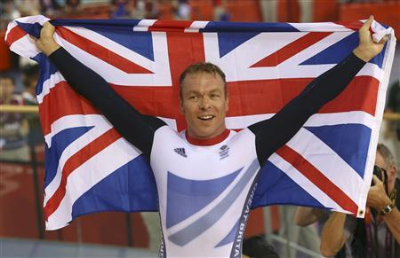 Britain's Chris Hoy celebrates after the track cycling men's keirin finals at the Velodrome during the London 2012 Olympic Games August 7, 2012. Hoy won the gold medal. REUTERS/Luke Macgregor