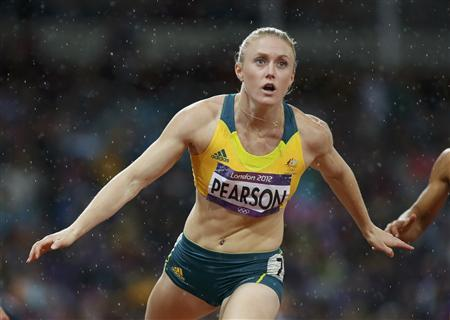 Australia's Sally Pearson competes to win in the women's 100m hurdles final during the London 2012 Olympic Games at the Olympic Stadium August 7, 2012. REUTERS/Lucy Nicholson