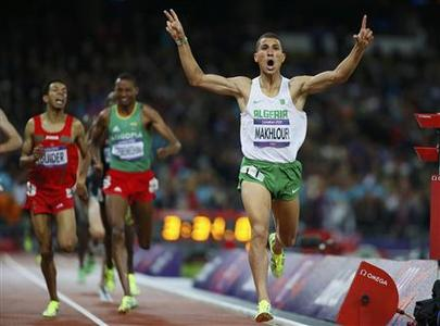 Algeria's Taoufik Makhloufi reacts as he wins the men's 1500m final during the London 2012 Olympic Games at the Olympic Stadium August 7, 2012. REUTERS/Lucy Nicholson