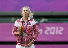 Russia's Maria Sharapova poses with her silver medal after receiving it during the presentation ceremony following the women's singles gold medal match at the All England Lawn Tennis Club during the London 2012 Olympic Games August 4, 2012. REUTERS/Stefan Wermuth