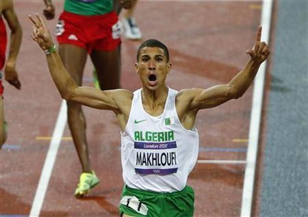 Algeria's Taoufik Makhloufi celebrates as he wins the men's 1500m final during the London 2012 Olympic Games at the Olympic Stadium August 7, 2012. REUTERS/David Gray