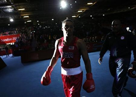 Errol Spence of the U.S. enters the ring before his Men's Welter (69kg) quarter-final boxing match against Russia's Andrey Zamkovoy (not shown) at the London Olympic Games August 7, 2012. REUTERS/Murad Sezer