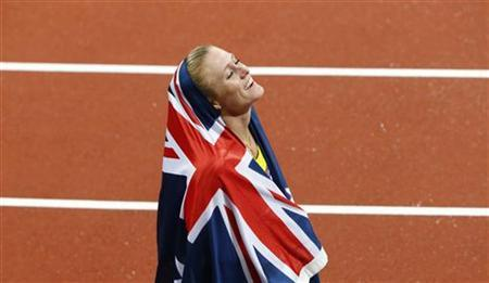 Australia's Sally Pearson smiles after she won the women's 100m hurdles final during the London 2012 Olympic Games at the Olympic Stadium August 7, 2012. Pearson crossed the line in 12.35 seconds, setting a new Olympic record. REUTERS/David Gray