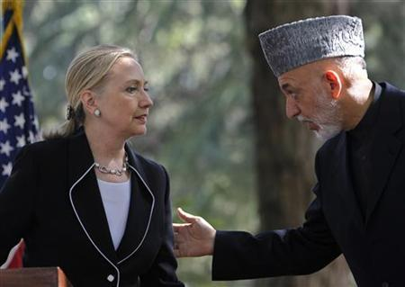U.S. Secretary of State Hillary Clinton (L) and Afghan President Hamid Karzai hold a joint news conference in Kabul July 7, 2012. REUTERS/Omar Sobhani