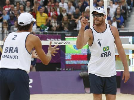 Brazil's Alison (R) and Emanuel celebrate a point against Latvia's Martins Plavins and Janis Smedins during their men's beach volleyball semifinal match at Horse Guards Parade during the London 2012 Olympic Games August 7, 2012. REUTERS/Suzanne Plunkett