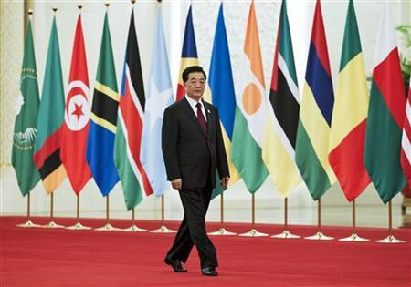 Chinese President Hu Jintao arrives for a group photo session for the Fifth Ministerial Conference of the Forum on China-Africa Cooperation (FOCAC) at the Great Hall of the People in Beijing July 19, 2012. REUTERS/Andy Wong/Pool