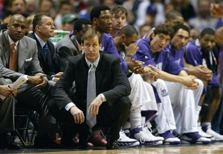 Former Milwaukee Bucks coach Terry Stotts (bottom) and his bench watch as the Detroit Pistons take charge late in the fourth quarter and build up a ten point lead in NBA playoff action in Milwaukee, Wisconsin May 1, 2006. REUTERS/Allen Fredrickson