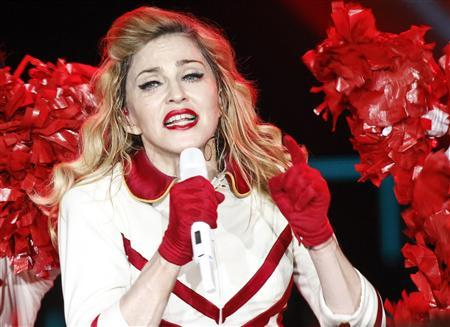 U.S. singer Madonna performs on stage during her MDNA tour at the Olympic Stadium in Moscow August 7, 2012. REUTERS/Maxim Shemetov