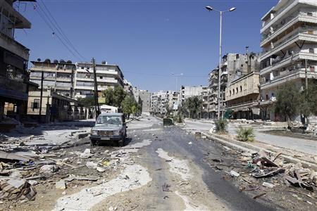 An empty street is pictured in Salah al- Din neighborhood following clashes between the Free Syrian Army fighters and Syrian Army soldiers in central Aleppo, August 8, 2012. REUTERS/Goran Tomasevic