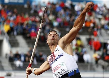 Roman Sebrle of Czech Republic competes during the javelin throw heats of the men's decathlon at the European Athletics Championships in Helsinki June 28, 2012. REUTERS/Dominic Ebenbichler