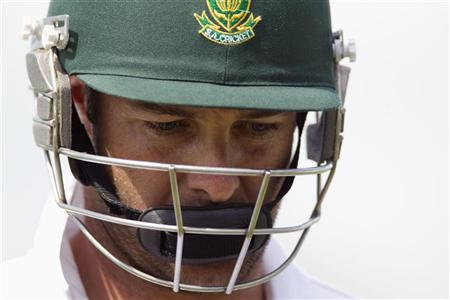 South Africa's Mark Boucher looks down as he leaves the ground after being bowled out by New Zealand's Mark Gillespie on day two of the second international cricket test match in Hamilton March 16, 2012. REUTERS/Nigel Marple