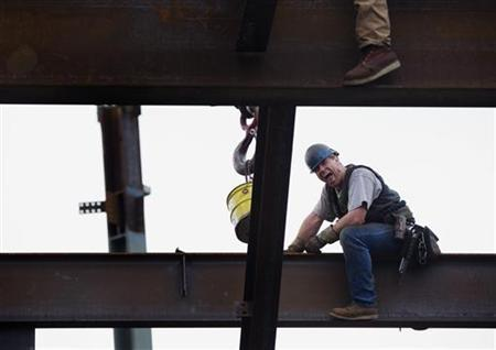 An ironworker laughs with a co-worker above the 93rd floor of One World Trade Center as the building nears 100 stories tall in New York March 23, 2012. REUTERS/Lucas Jackson