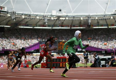 Saudi Arabia's Sarah Attar (R) starts her women's 800m round 1 heat during the London 2012 Olympic Games at the Olympic Stadium August 8, 2012. REUTERS/Lucy Nicholson