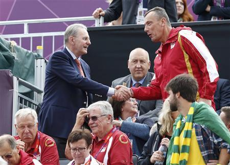 International Olympic Committee President Jacques Rogge (top L) greets an Olympic official as he and his wife Anne (seated C) arrive to watch the men's beach volleyball semifinal matches at Horse Guards Parade during the London 2012 Olympic Games August 7, 2012. REUTERS/Suzanne Plunkett