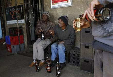 Men chat as they drink beer at a sheeben (bar) in Soweto, southwest of Johannesburg August 8, 2012. REUTERS/Siphiwe Sibeko