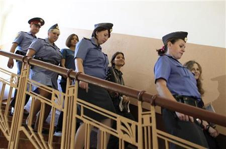 Nadezhda Tolokonnikova (3rd L), Yekaterina Samutsevich (3rd R) and Maria Alyokhina (R), members of female punk band ''Pussy Riot'', are escorted by police before a court hearing in Moscow August 8, 2012. REUTERS/Sergei Karpukhin