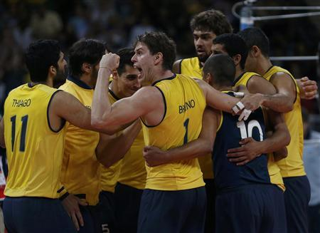 Brazil's players celebrate defeating Argentina in their men's quarterfinal volleyball match at Earls Court during the London 2012 Olympic Games August 8, 2012. REUTERS/Ivan Alvarado