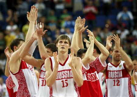 Russia's Andrei Kirilenko (C) and his teammates celebrate victory with the crowd after their men's quarterfinal basketball match against Lithuania at the North Greenwich Arena in London during the London 2012 Olympic Games August 8, 2012. REUTERS/Mike Segar