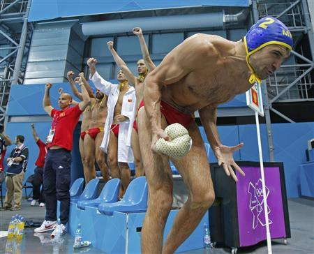Montenegro's Drasko Brguljan (R) and the bench celebrate a goal against Spain during their Men's Quarterfinal water polo match during the London 2012 Olympic Games August 8, 2012. REUTERS/Sergio Moraes