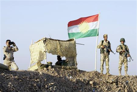Kurdish Peshmerga soldiers look on at a guard post during a deployment in the area near the northern Iraqi border with Syria, which lies in an area disputed by Baghdad and the Kurdish region of Ninawa province, August 6, 2012. REUTERS/Azad Lashkari
