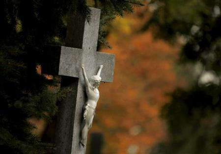 A crucifix is seen at the central cemetery two days ahead of All Saints day in Vienna October 30, 2009. REUTERS/Leonhard Foeger