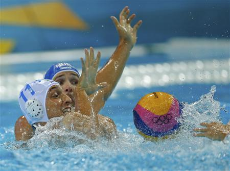 Italy's Matteo Aicardi (L) battles Hungary's Marton Szivos for the ball during their Men's Quarterfinal water polo match during the London 2012 Olympic Games August 8, 2012. REUTERS/Laszlo Balogh