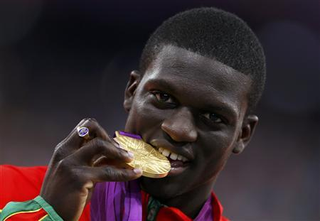 Grenada's Kirani James bites his gold medal during the men's 400m victory ceremony at the London 2012 Olympic Games at the Olympic Stadium August 7, 2012. REUTERS/Eddie Keogh
