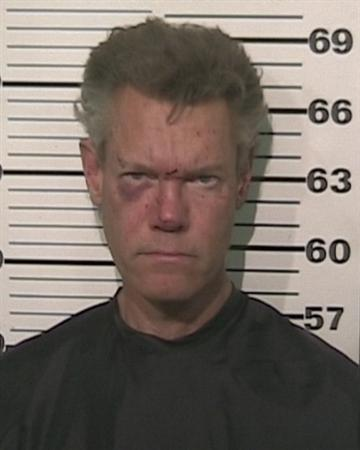 Country Singer Randy Travis is pictured in this booking photo supplied by Grayson County Texas Sheriff's office. Travis was arrested near his hometown about 60 miles north of Dallas late Tuesday night for drunk driving. REUTERS/Grayson County Texas Sheriff's office/Handout