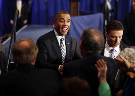 U.S. President Barack Obama greets members of the audience after delivering remarks at an election campaign fundraiser in Stamford, Connecticut, August 6, 2012. REUTERS/Jason Reed