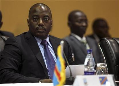 Democratic Republic of Congo's President Joseph Kabila (L) listens to deliberations during the International Conference on the Great Lakes Region (ICGLR) at the Commonwealth Resort Hotel Munyonyo in the capital of Kampala August 8, 2012. REUTERS/Edward Echwalu