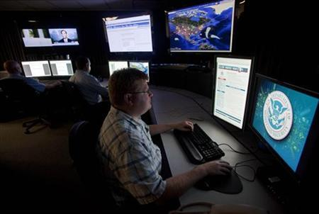 Analysts work in a watch and warning center of a cyber security defense lab at the Idaho National Laboratory in Idaho Falls, Idaho September 29, 2011. REUTERS/Jim Urquhart