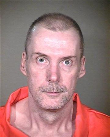 Daniel Wayne Cook, 51, is shown in this handout photo obtained by Reuters on August 8, 2012. Cook, who tortured, raped and strangled two co-workers in 1987 was put to death in Arizona on Wednesday, more than a year after the U.S. Supreme Court temporarily blocked his execution to consider whether he had adequate counsel. He was pronounced dead at 11:03 a.m. from a lethal injection administered at the state prison in Florence, 60 miles (97 miles) southeast of Phoenix, state officials said. REUTERS/azcorrections.gov/Handout