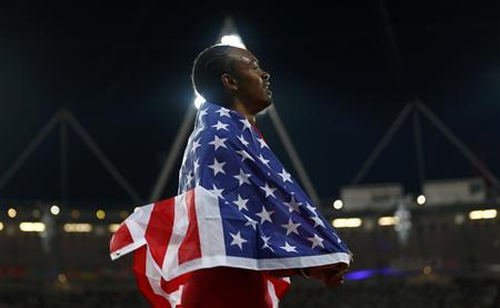 Aries Merritt of the U.S. celebrates after winning the men's 110m hurdles final during the London 2012 Olympics Games at the Olympic Stadium August 8, 2012. REUTERS/Eddie Keogh