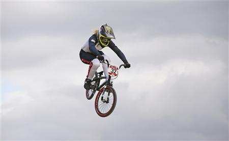 Brooke Crain of the U.S. competes in the women's BMX seeding run during the London 2012 Olympic Games at the BMX Track in the Olympic Park August 8, 2012. Crain crashed during the race. REUTERS/Paul Hanna