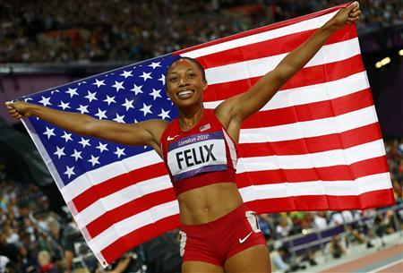 Allyson Felix of the U.S. celebrates after she won gold in the women's 200m final during the London 2012 Olympic Games at the Olympic Stadium August 8, 2012. REUTERS/Kai Pfaffenbach