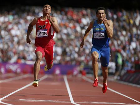 Ashton Eaton of the U.S. and Ukraine's Olesksiy Kasyanov (R) run in their men's decathlon 100m heat at the London 2012 Olympic Games at the Olympic Stadium August 8, 2012. REUTERS/Lucy Nicholson