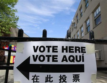 A sign is seen outside a polling place in Brooklyn, New York April 24, 2012. REUTERS/Brendan McDermid