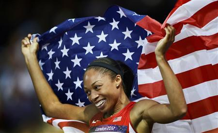 Allyson Felix of the U.S. celebrates after she won gold in the women's 200m final during the London 2012 Olympic Games at the Olympic Stadium August 8, 2012. REUTERS/Dylan Martinez