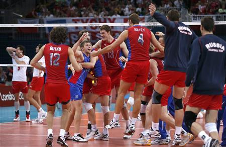 Russia's players celebrate defeating Poland during their men's quarterfinal volleyball match at Earls Court during the London 2012 Olympic Games August 8, 2012. REUTERS/Ivan Alvarado