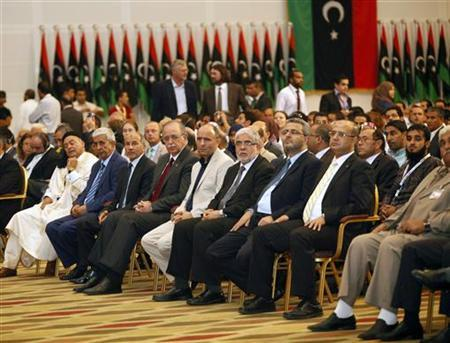 Libyan National Transitional Council (NTC) Chairman Mustafa Abdel Jalil (3rd L seated) and Libya's Prime Minister Abdurrahim El-Keib (4th L seated) attend a news conference by Nouri al-Alabbar, Chairman of the Electoral Commission National Congress, to announce the results of the Libyan General Assembly election in Tripoli July 17, 2012. REUTERS/Ismail Zitouny