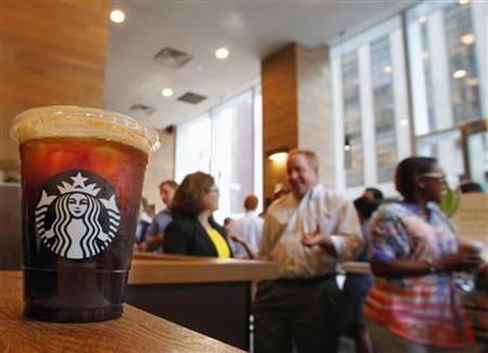 An iced coffee sits on a counter in a Starbucks outlet in New York July 25, 2012. Starbucks Corp. will report earnings on July 26. REUTERS/Brendan McDermid