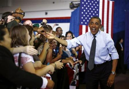 U.S. President Barack Obama arrives at an election campaign rally at the Auraria Event Center in Denver, Colorado, August 8, 2012. REUTERS/Jason Reed