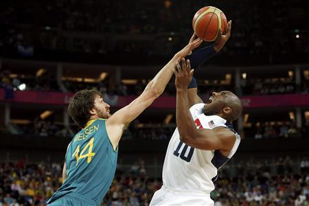 Kobe Bryant (R) of the U.S. has his shot blocked by Australia's Matt Nielsen during their men's quarterfinal basketball match at the North Greenwich Arena in London during the London 2012 Olympic Games August 8, 2012. REUTERS/Sergio Perez