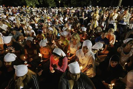 Sikhs and members of the community attend a vigil in Oak Creek, Wisconsin, August 7, 2012. REUTERS/John Gress